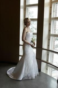 Wedding dress with lace and satin. Pic by Tanja Renkola